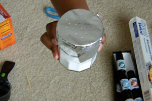 cut aluminum foil to fit around the jar and poke holes in the top.