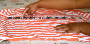 Cut straight across the shirt. No worries if it is not perfect.
