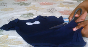 Cut the bottom half of the first onesie.